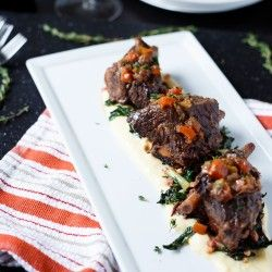 Braised Short Ribs.  These were delish, just make sure to make day before and place in refrigerator to solidify fat,,,then just spoon the hardened fat off into garbage,  The broth made a great soup (after more fat removal)