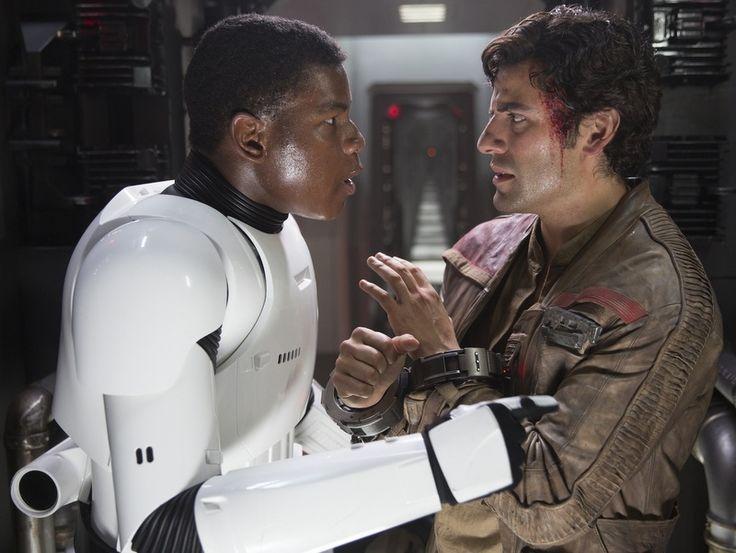 John Boyega as Finn (in stormtrooper uniform) and Oscar Issac as Poe Dameron.