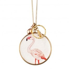 A cute and quirky necklace from the 'Something Like Paradise' collection. It has a cluster of charms and a pendant featuring a pink flamingo bird on a pearlised silver background.