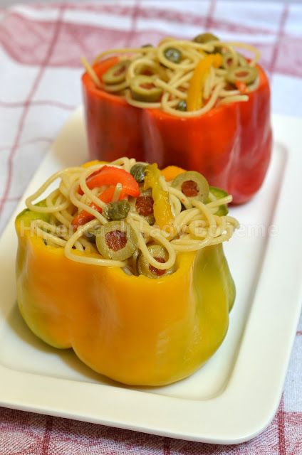Peperoni ripieni di spaghetti (Stuffed peppers with spaghetti with a sauce of peppers cut into small strips, olive oil, garlic, anchovies, capers, parsley, stuffed green olives, bread crumbs, salt and pepper.