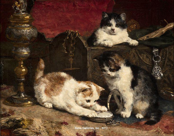 Gatitos que juegan con un reloj de bolsillo