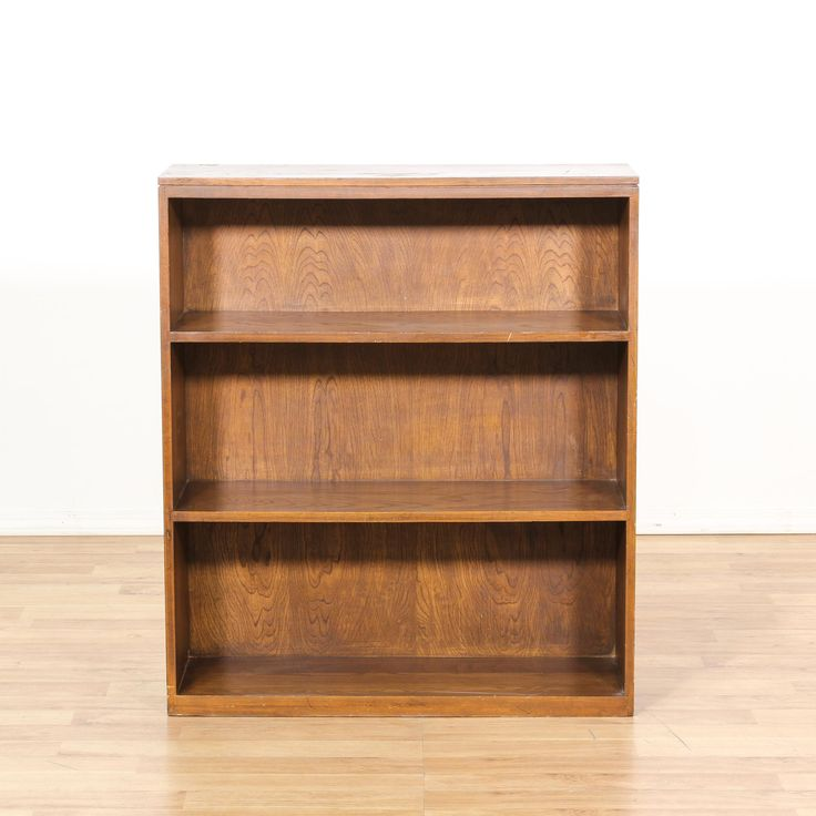 This bookcase is featured in a solid wood with a glossy dark oak finish. This traditional style bookshelf has 3 sections and simple straight sides. Perfect for a child's room! #americantraditional #storage #bookcase&shelving #sandiegovintage #vintagefurniture