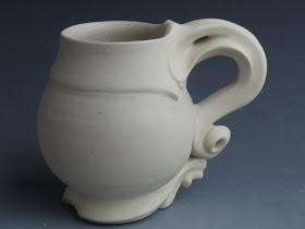 really neat handle on this ceramic pottery mug
