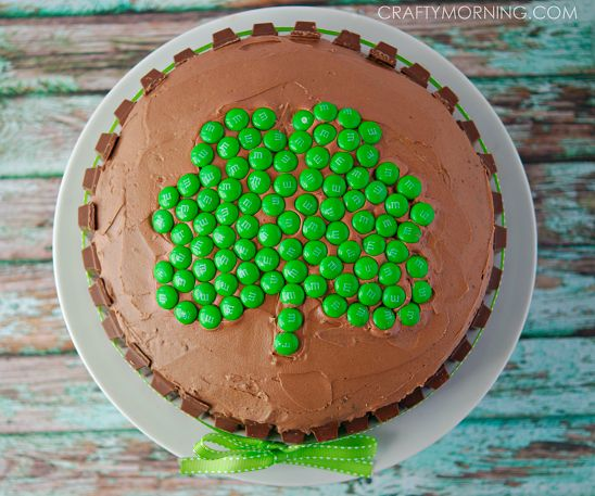 Shamrock Kit Kat Cake for a St. Patrick's Day -  Use green m&ms and kit kat chocolate bars to decorate.