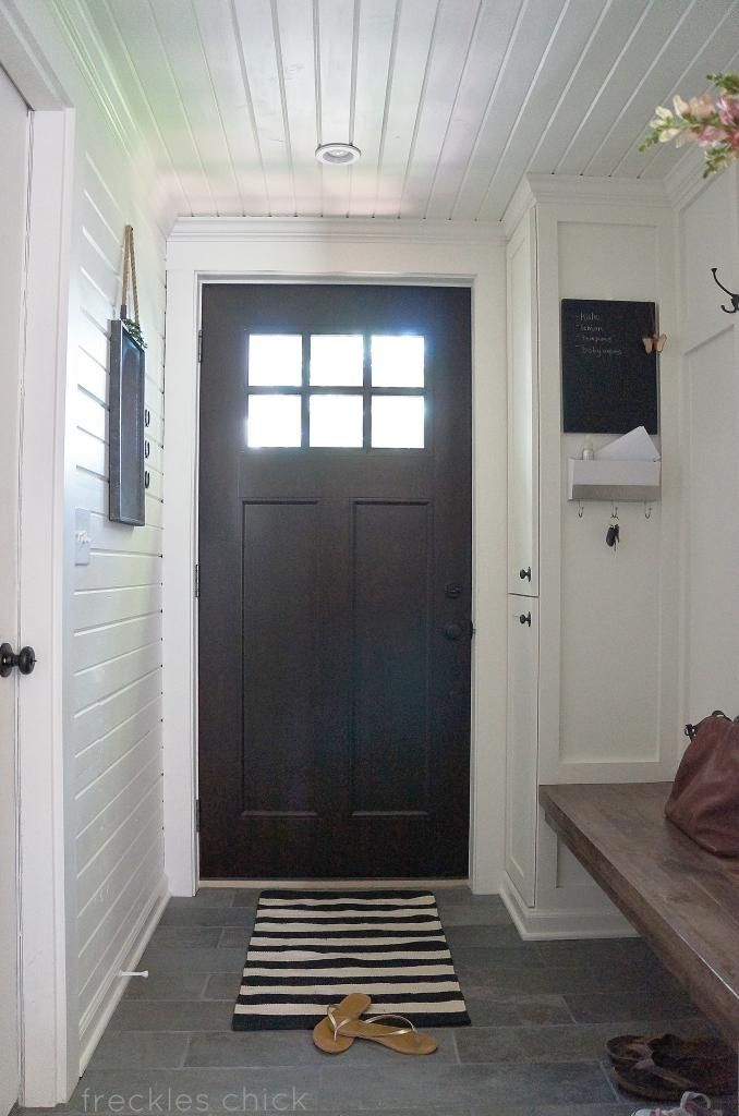 Mini mudroom: take two - and love all the paneling We love the simplicity of this bench the most and its nice depth. We like floor too. Door could be a front door style.