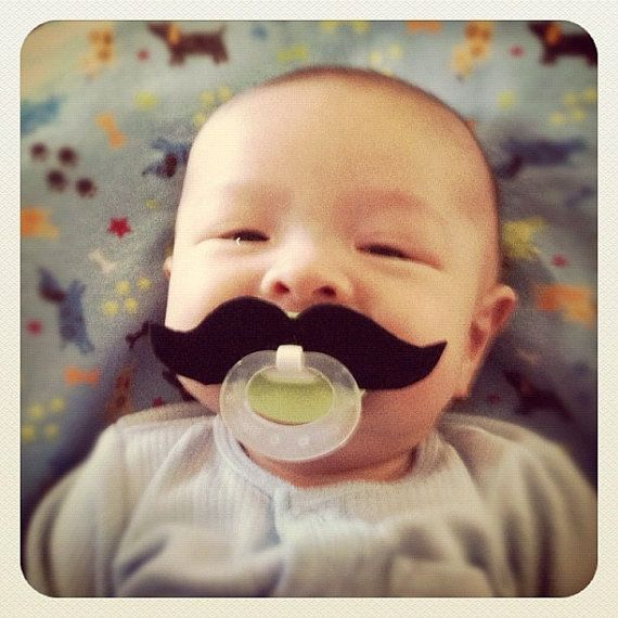Hours of amusement. For the parents. Mustache Pacifier  Black Strongman by BabyHipsters on Etsy, $9.00