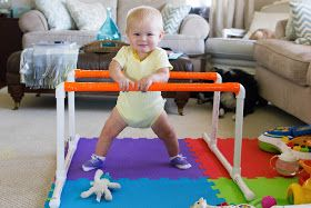 Girl v. The World: Naptime Projects: Pull Up Bars. DIY baby pull up bar Montessori baby nursery.