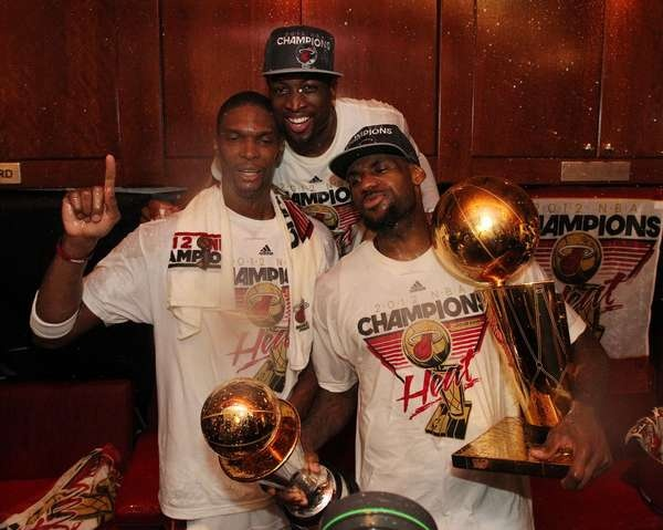 Chris Bosh, Dwyane Wade, and LeBron James of the Miami Heat pose for a photo in the locker room after winning the NBA Finals - www.fansedge.com/Chris-Bosh-Dwyane-Wade-LeBron-James-Miami-Heat-NBA-Finals-Game-5-6212012-_-1176956560_PD.html?social=pinterest_nbafinals_bigthree