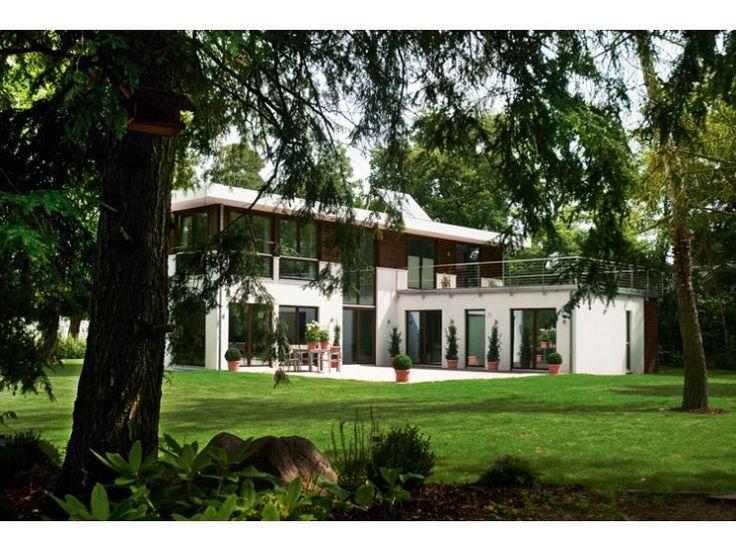 Bauhaus einfamilienhaus von haacke haus gmbh co kg for Villa flachdach