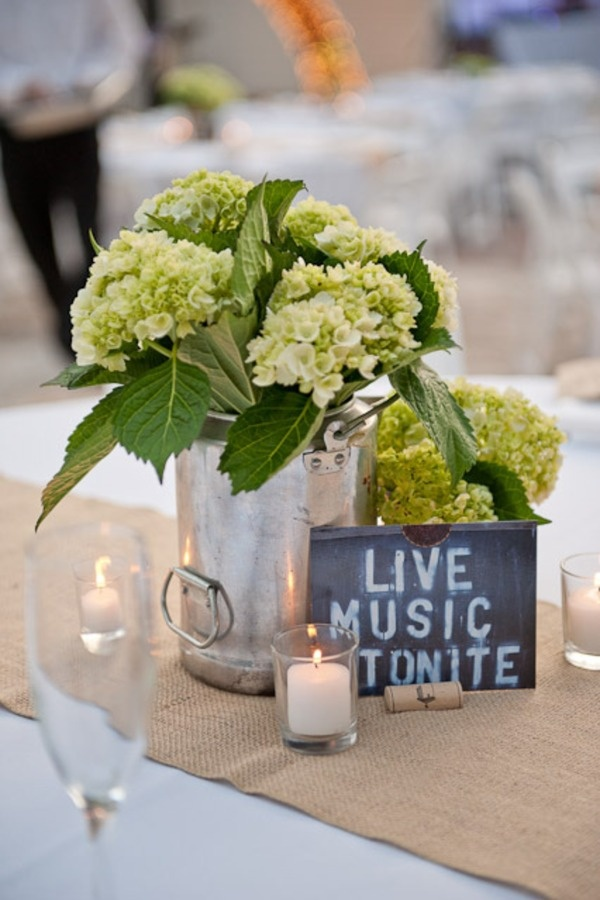 Silver bucket centerpieces with simple, green flower arrangement