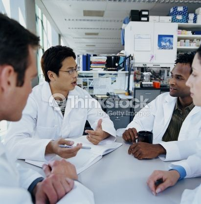Stock Photo : Group of research scientists meeting in research lab