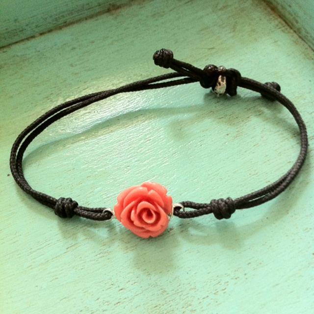 Lucite coral flower in grey cord resizable bracelet.