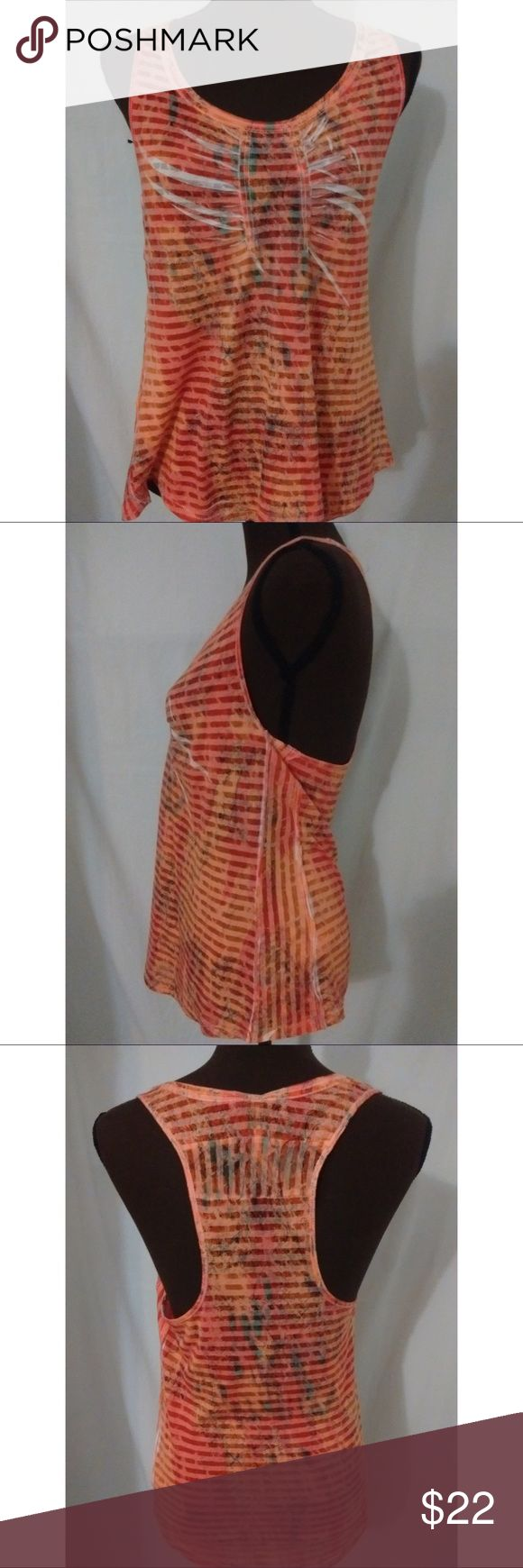 Free People Women's Striped Tank Top Medium sized tank top. Striped tank. Shades of orange with decorative dark swirls. Armpit to armpit 16 inches. Length 26 inches. Free People Tops Tank Tops