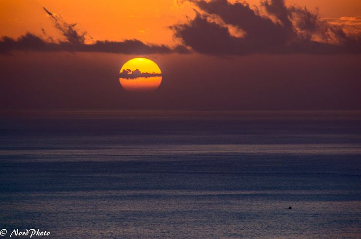 """A big, beautiful sunset with a small fishing boat in the foreground. If you like are into surf and nature photography you should check out my facebook page here: <a href=""""https://www.facebook.com/nordphoto"""">https://www.facebook.com/nordphoto</a>"""