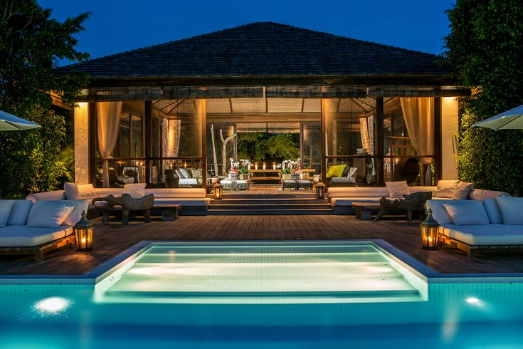 Fashion designer Donna Karan is selling a portion of her longtime family retreat on Parrot Cay in the Turks and Caicos Islands for $39 million. The dining pavilion, shown, was intended as 'a family gathering place' with seating for more than 20 people, said co-listing agent Katherine Baryluk of Regency, the exclusive affiliate of Christie's International Real Estate for Turks and Caicos.
