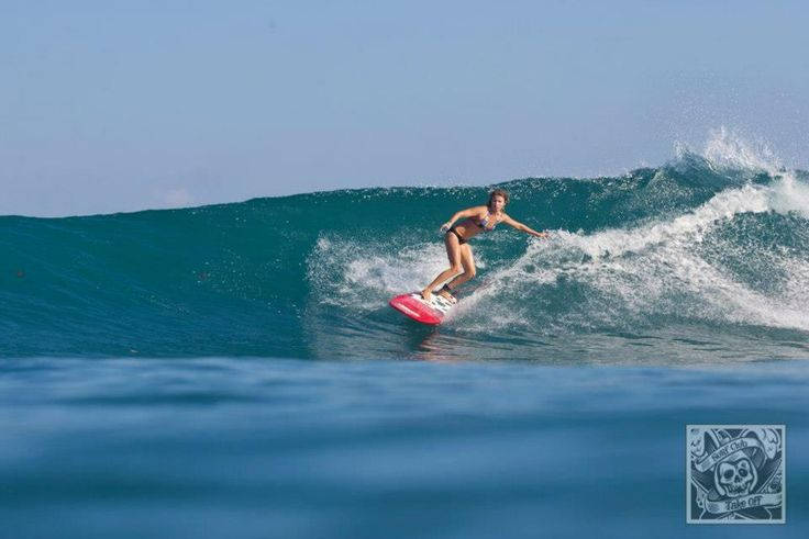 SUrfer girl in action at G-Land, East Java, Indonesia