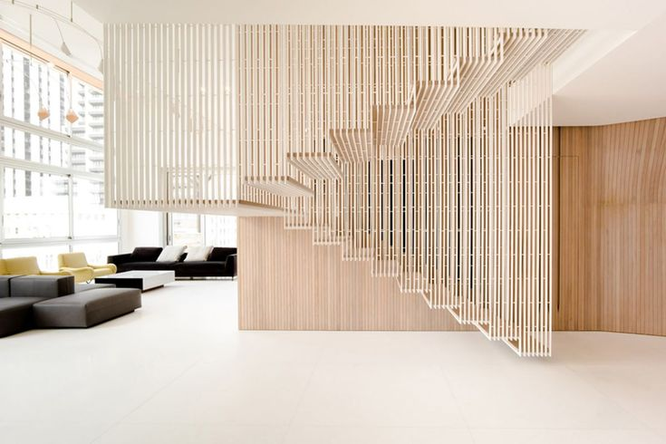 Penthouse revamp features wavy walls and steel-cage staircase - Curbed