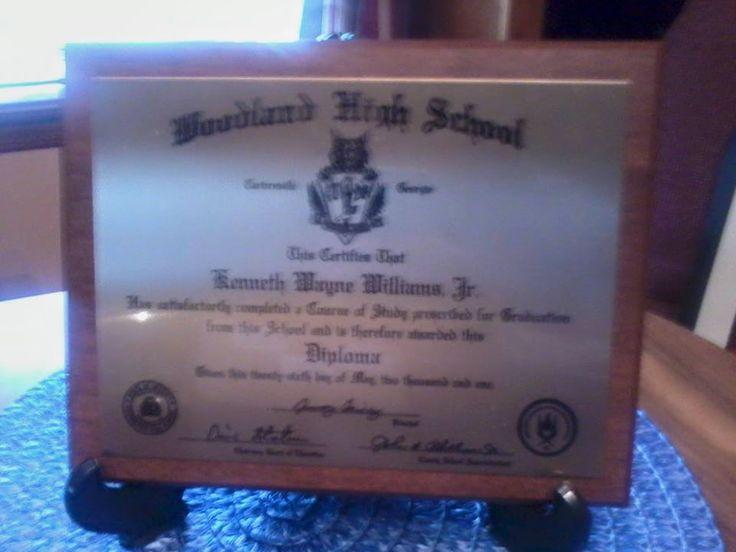 "This is Kenneth Wayne ""Redd"" Williams Jr.'s graduation diploma. 2001 Woodland high school Wildcat Senior Superlative, alumni. — in Cartersville, Georgia."