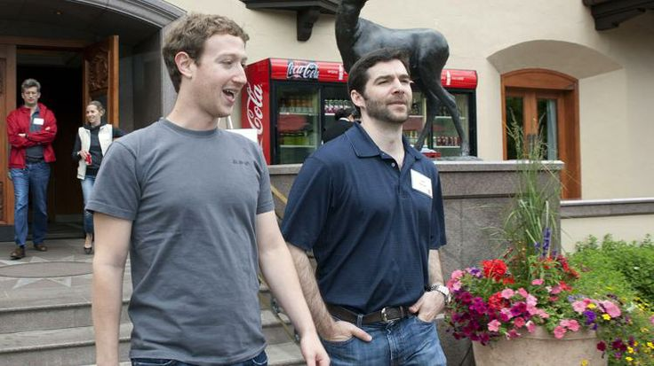 Facebook CEO Mark Zuckerberg, left, walks with Jeff Weiner, CEO of LinkedIn at the Sun Valley Inn during the 2011 Allen and Co. Sun Valley C...