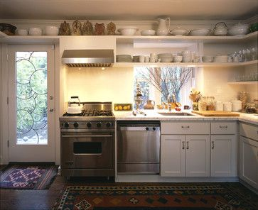 Like the idea of storing extra dishes on ceiling height shelves, lighting can be done on a timer with hidden rope lights - Montlake traditional kitchen via houzz.com