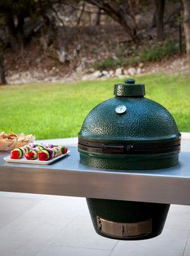This floating green egg grill adds a clean, modern touch to the kitchen design.