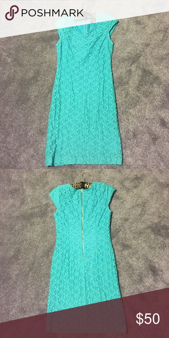 ON SALE!!! Beautiful dress! Only worn a few times! Aqua dress size XS. Worn only a few times. Very good condition. The Limited Dresses