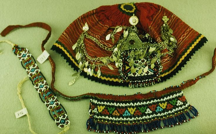 Traditional ornaments for a Turkish bride from the northern part of the Burgaz province (Bulgaria).  Mid-20th century.  A hat, a necklace and a bracelet; made with small glass beads – the cotton hat has additionally small silver(y) chains.  (Kavak Folklor Ekibi & Costume Collection-Antwerpen/Belgium).