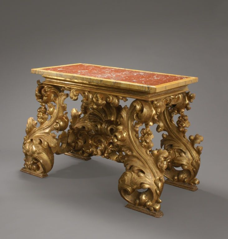 An italian baroque carved giltwood console table from a for Antique baroque furniture