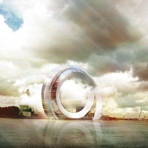 """A team of Dutch companies has unveiled a proposal for a huge circular wind turbine that doubles as an apartment block and hotel, and also includes a rollercoaster.  Billed as """"the most innovative windmill in the world"""", the Dutch Windwheel is intended as a landmark attraction for Rotterdam's waterside."""