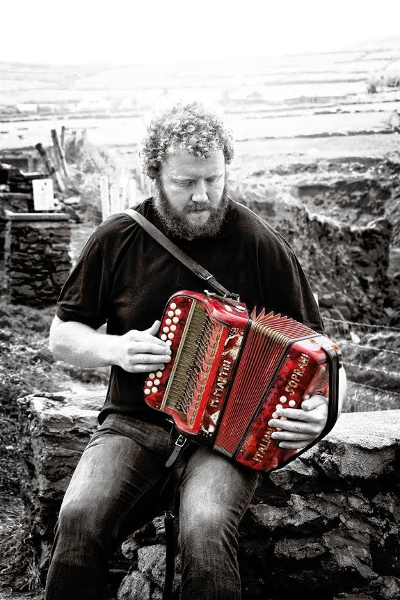 Jan Kentala's picture of tour guide Conor performing his music box, a traditional Irish instrument on her vacation in Ireland.