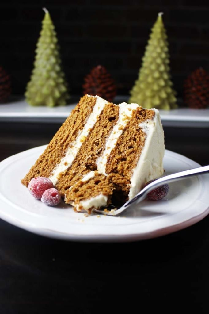 This moist gingerbread layer cake with brown butter cream cheese frosting is super simple to make and is a festive holiday cake that the whole family will love. #gingerbreadcake #holidaybaking #christmascake #sugaredcranberries #brownbutterfrosting