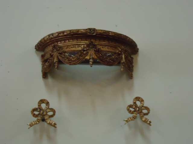 Louis XVI style ciel de lit bed crown and curtain tiebacks.