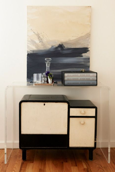 oh. i like this. i love this. old cabinet nestled beneath new acrylic console? with watercolor? and rather monochromatic? very nice.