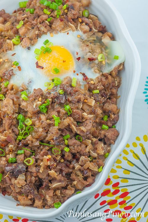 Pork Sisig is a popular appetizer that originated from the culinary capital of the Philippines : Pampanga. This delicious dish can also be categorized as a main dish. Pork Sisig was invented by the late Lucia Cunanan. She is popularly know as Aling Lucing - the sisig queen.