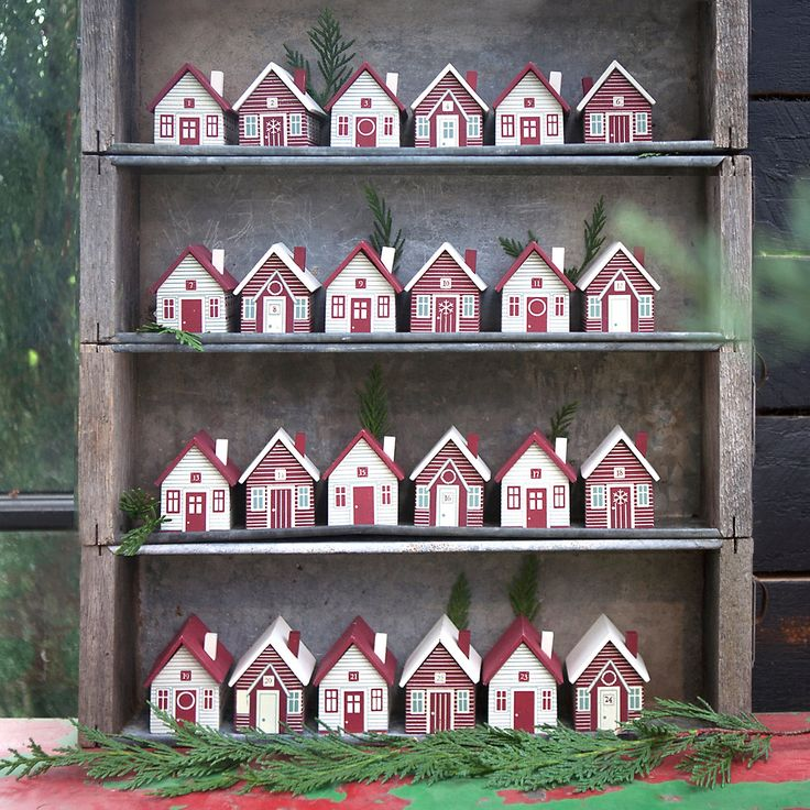 Advent Houses. 120. Set. Boxes to hold present. Make from wood blocks with number printed on bottom.  Turn upright each day?
