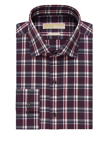 <ul> <li>Non iron dress shirt in timeless plaid</li>  <li>Spread collar</li>  <li>Button Front</li>  <li>Long sleeves</li>  <li>Buttoned cuffs</li>  <li>Cotton</li>  <li>Machine wash</li>  <li>Imported</li> </ul>