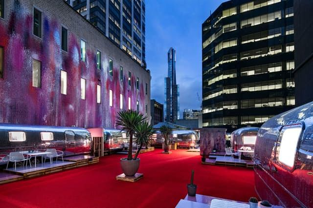 Hotels are just so... typical, you know? Lobbies, ice machines, an obvious lack of aluminum. Instead of rooms off a hallway, Australia's Notel offers you actual Airstream trailers on the roof of a parking garage.
