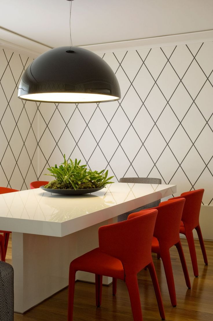 Dinette - Grid wallpaper with vibrant red chairs and a black dome chandelier....lovely.