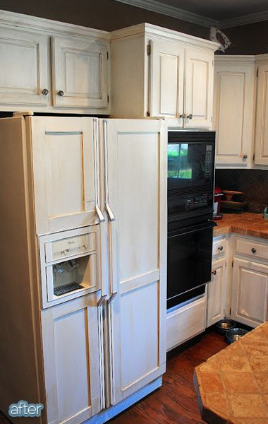 AFTER: She added pieces of trim with Liquid Nails and painted the whole darn thing to better blend in with her cabinets. See the whole process on her blog Amazing Grays.