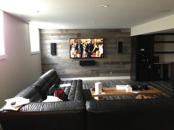 Beautiful in-wall speaker system installed on a wall covered with barnboard.  What an innovative wall treatment!  Great for sound, too!