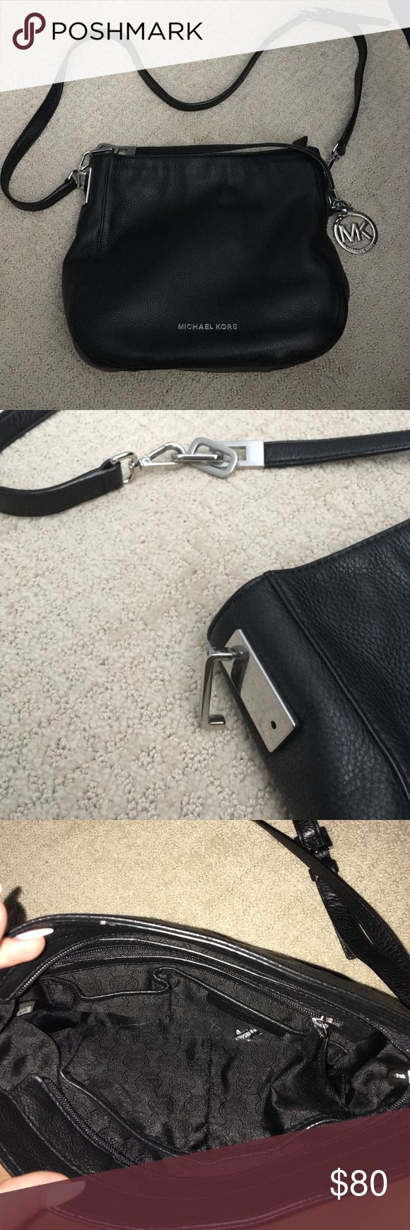 Michael Kors Purse This bag is super cute and in perfect condition EXCEPT that the hook that hold the strap on has fallen off and I do not know how to fix it. Michael Kors Bags Crossbody Bags