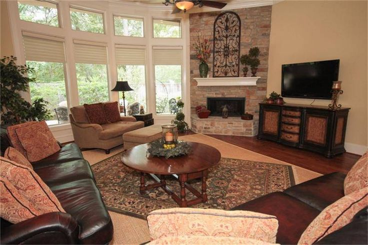 Fireplace stone fireplace design faux fireplace - Living room layout with corner fireplace ...