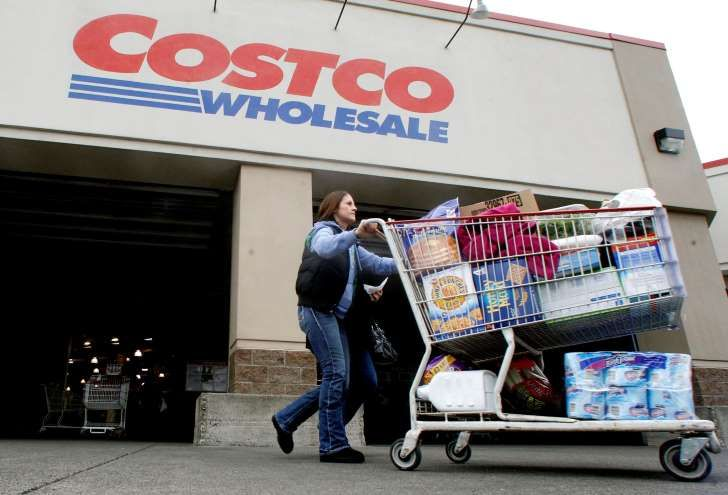 In this Wednesday, Dec. 7, 2011, file photo, a shopper leaves a Costco store in, Portland, Ore.