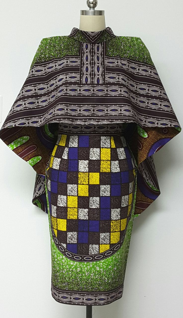 This is a Versatile Reversible African Print Hi-Lo Cape and Fully Lined pencil skirt with open slit back. You can pair the Reversible Cape with Pants, Skirts, and dresses. It will surely enhance your wardrobe. Finished skirt length is between 26 and 27 inches and cape is between 16-18 inches.   INCLUDED: • One skirt and One Cape  Model is wearing size 8.  Other sizes available DETAILS: • African Print.  Care Instructions: Dry Clean Only. Visit my shop: https://www.etsy.com/shop/NanayahStudio…