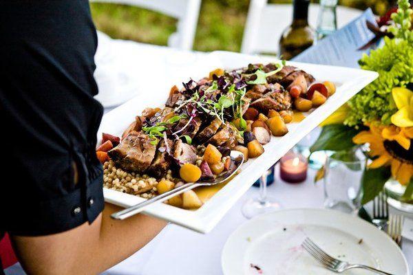 As such, there is a rise in the choice of Family Style wedding menus.  Blending guest self portioning and table-side service, guest enjoy each wedding menu item served on large platters or dishes to each individual table.  Passing the plate and encouraging conversation, guests have the opportunity to break the ice while breaking bread.  Family style buffets are generally less expensive than sit down dinners but allow your guests the luxury of table side service. Angel likes maybe