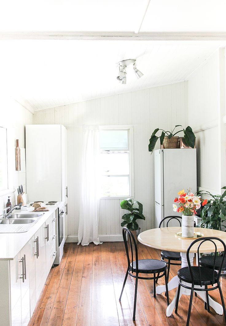 white kitchen with bistro chairs and round table