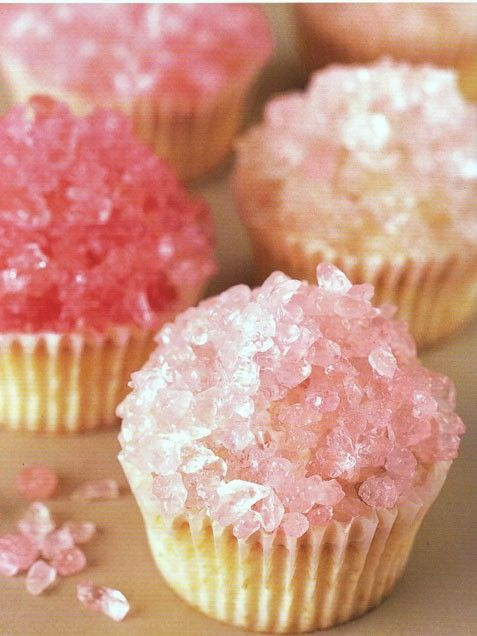 "Gorgeous and gush-worthy, these rock candy crystal cupcakes will delight your little princess -- and they couldn't be easier to make: just crush the colored ""gems"" onto frosted cupcakes."