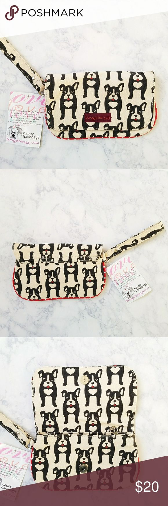 """Bungalow 360 Boston Terrier Dog Wristlet Bungalow 360. Wristlet wallet. Black dog (Boston Terrier) pattern. Vegan Cotton Canvas. Flap top with magnetic closure Zip top compartment. Interior zipper pocket. Red white polka dot lining. 9"""" x 5""""  6"""" wristlet strap. Brand new with tags! Bungalow 360 Bags Clutches & Wristlets"""