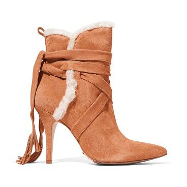 On SALE at 50% OFF! shearling-trimmed suede ankle boots by Schutz. US sizing Schutz tan boots . Heel measures approximately 100mm/ 4 inches . Suede . Pull tab, tasseled ties, ecru shea...