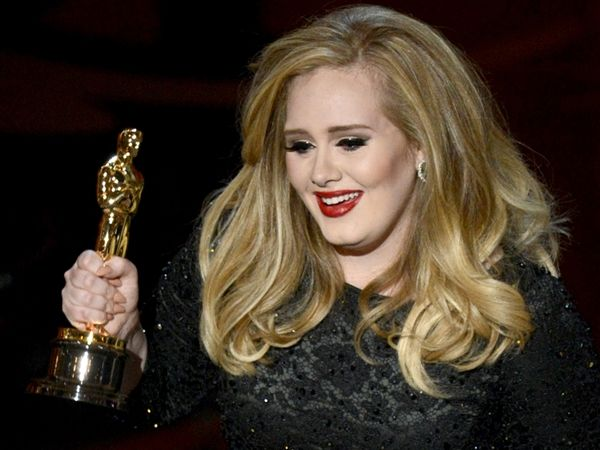 """Adele accepts the Oscar for best original song for """"Skyfall."""" (Photo: Kevin Winter / Getty Images) #Oscars"""